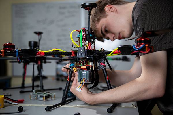 Student working on drone electronics