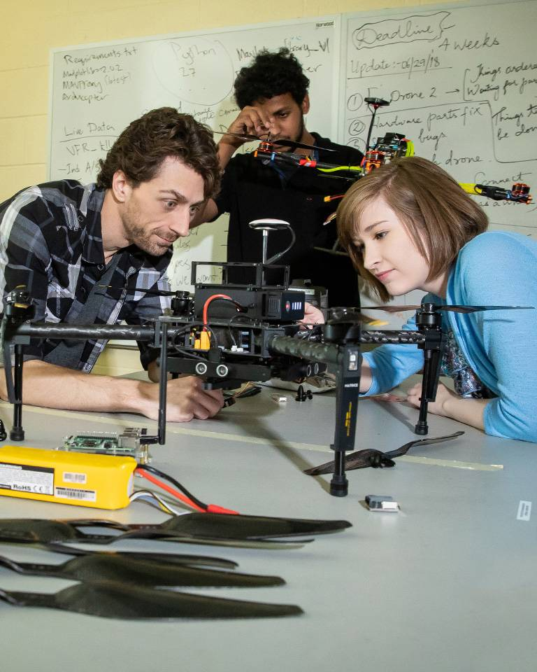 Engineering students working on drone